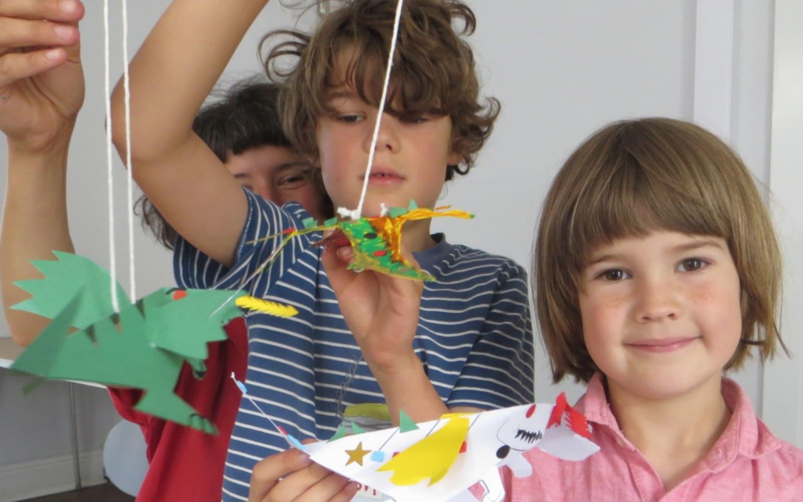 Children at a dinosaur craft workshop